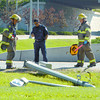 City of Prince George firefighters look over a light pole that was taken out by a truck Thursday morning on North Nechako Road by the Parkhill Centre. The damaged light pole affected the traffic lights as well. Citizen photo by Brent Braaten
