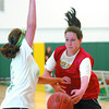 Sam Hamilton, left, checks Kasey Reiter Thursday at the Northern sports Centre during the UNBC Timberwolves 11th Annual basketball camp. More camps will be offered in August. Citizen photo by Brent Braaten