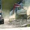 An excuvator creates some dust Saturday morning as more of the old Northern Linen on Second avenue gets demolished. Citizen photo by Brent Braaten