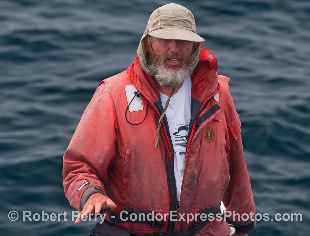 John Calambokidis in survival suit and sun-protective hat at work on the Santa Barbara Channel.