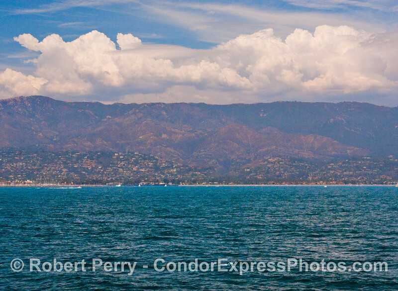 The Santa Ynez mountains and the City of Santa Barbara viewed with storm clouds from approximately 2 miles out at sea.