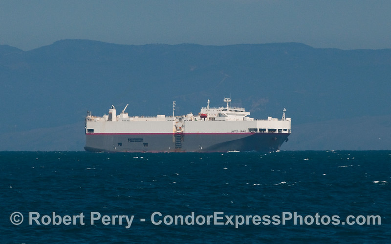 "The car carrier ""United Spirit"" heads down the Santa Barbara Channel towards the docks in Port Hueneme."