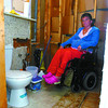 Carrie McAstocker, shows her bathroom she paid to be renovated to be wheelchair accessable. McAstocker paid over $6000.00 to a contractor who took the money and left her house in this condition. Citizen photo by David Mah