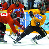 Sean Landry, left, sends Jari Erricson flying in the Cariboo Cougars camp Sunday at the Coliseum.  Citizen photo by David Mah