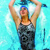 Emily Williams enters the water in the 100 meter back stroke, in the Pisces Regional Swim meet at the Prince George Aquatic Centre. Citizen photo by David Mah