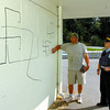 Peter Campbell, with Prince george minor baseball, and RCMP CST. Mike Sabulsky view swaztikas and racial names written in large felt pen around the Joe Martin concession stand and other vandalism in the stands. Citizen photo by David Mah