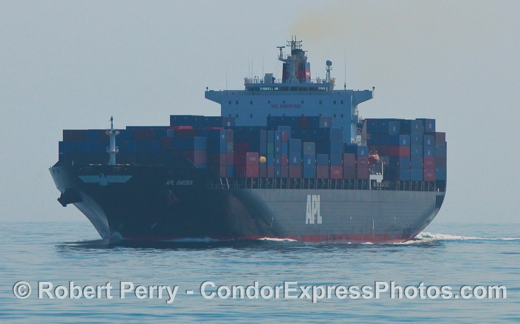 "In the moring light, the APL container vessel ""APL Sweden"" heads out of southern California in the northbound shipping lane of the Santa Barbara Channel."