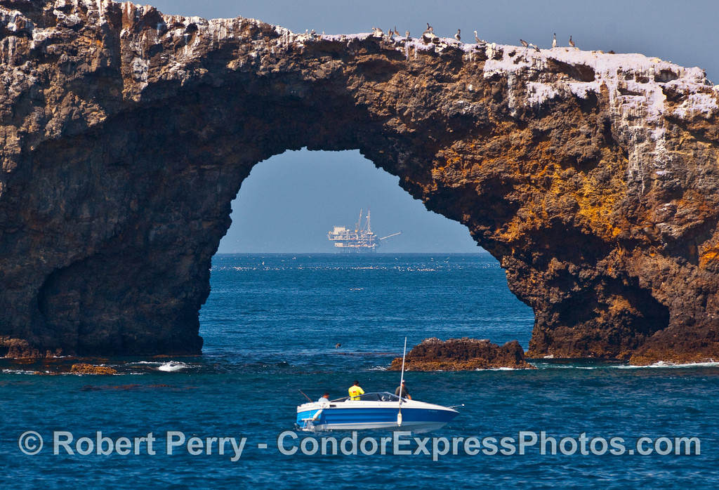 Looking northward through Arch Rock to a mass of seabirds on the water and Platform Gail on the horizon...East Anacapa Island.
