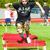 Kaiden Goggin, 11, of the Wolf Pack All Star Hockey team jumps hurdles during dryland training at Masich Place Stadium. The Wolf Pack and Ice Hawks were starting their training early. Citizen photo by David Mah