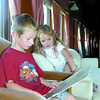 Gavin Vaillancourt, 5, and Amara Vaillancourt, 3, look over an old map of british columbia in the Nechako car at the Railyway and forestry Museum. Citizen photo by Brent Braaten