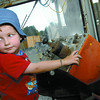 Tristan Swartz, 4, trys the controls of Laturneau at the Railway and forestry Museum during Family fun day Saturday. Citizen photo by Brent Braaten