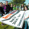 Tuppy, left, Gabby, 1 1/2, and Shane Hoehn, Lindsay Timmermans, Sophie Hartman, 2 months, Alyson Gorley-Cramer, Max, Liza, Ryan, and Kate, 10 Arnold, are reminding you to take part in the Terry Fox Run, which is a family event. Citizen photo by David Mah