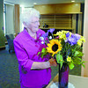 Information desk voulnteer Dorothy Alderson will be greeting every one at the new Gateway Residential Care Facility. Here, she brightens up her desk with fresh flowers. Citizen photo by David Mah