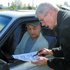 Dave Gourley, right, manager operations Pacific Vehicle Testing Technologies, goes over the Emissions Testing sheet with Zsigmond Balogh, at the free vehicle emissions tests the CN Centre parking lot. Free tests will be going Friday and Saturday from 10-4. Citizen photo by David Mah