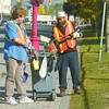 Scott Stalker, left, and Brian Bartlett, with the Prince George Brain Injured Group worked their way along Victoria Street and 20th Avenue to keep the Gateway clean Thursday. Citizen photo by David Mah