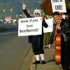 A.J. Mittendorf with the PGSO dressed up like Beethoven and Steve Collins played cello along 15th Avenue Wednesday morning to promote the symphonys concert this Saturday at 7:30 in Vanier Hall.  Citizen photo by Brent Braaten