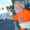 Darrell Rutledge with Telus with papers at 6th and Victoria Street.  Citizen photo by Brent Braaten