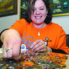 Sandy Ramsay counts the money raised at this yers Raise-a-Reader day.  Citizen photo by Brent Braaten