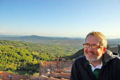 David looking out over the Tuscan hills from the top of Roccatederighi