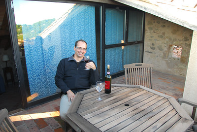 Tim enjoying a glass of wine on the rooftop