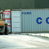 Containers at the CN container yard get loaded with lumber Tuesday afternoon.  Citizen photo by Brent Braaten