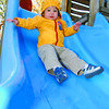 Lincolin MacEachern, 1 1/2 is a little tenataive as he trys the slide at Fort George Park Thursday afternoon.  Citizen photo by Brent Braaten