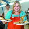 Laurie hookler helps serve the meals at the St. Vincent de Paul Thankgiving dinner Sunday.  Citizen photo by Brent braaten