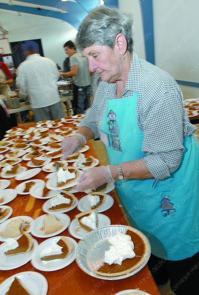Norma Allison dishes up the pumkin pie at the St. Vincent de Paul Thanksgiving dinner Sunday at the Sacred Heart Auditorium. Citizen photo by Brent Braaten