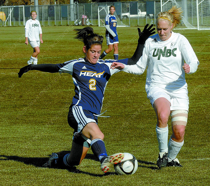 UBCO Alexa Kennedy, left, and UNBC Laura Gastor during a game Saturday.  Citizen photo by Brent Braaten