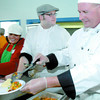 Left to right Rebecca Gilbert, William Miller and Brock Gable help dish up the meals at the St. Vincent de Paul Thanksgiving dinner. CNC Culinary students and past students prepared the dinner and then helped  serve it. Citizen photo by Brent Braaten