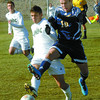 UNBC Scott Debianchi, left, and UBCO Lars Seitzinger go for the ball during a game Saturday.  Citizen photo by Brent Braaten