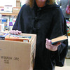 Cheryl Orydzuk, searches for more books to add to her collection at the Friends of the Library book sale Saturday at the Kinsmen Place. Over 10,000 books were available by donation. Citizen photo by David Mah