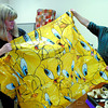 Christine and Bill Sullivan checked out a Tweety shower curtain at the garage sale at Our Saviour's Lutheran Church Harvest Fair Saturday. A large variety of craft fair items were available. Citizen photo by David Mah