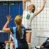 Sydney Thorne, #8, of PGSS winds up to spike towards #7, Taylor Kandlor, of College Heights. Citizen photo by David Mah