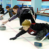 Beginner curlers, Grayson Wagner, 9, front, Gavin Bernard, 11, and 16 other kids aged between 4 - 12, took part in the Little Rocks introduction to curling at the Prince George Golf and curling Club Sunday. Here, the guys slide their first rocks. Citizen photo by David Mah