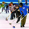 18 children aged 4 - 12 learned to curl in the Little Rocks program Sunday at the Prince George Golf and Curling Club. Here, they learned sweeping skills.  Citizen photo by David Mah