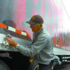 Trucker Richard Yuenger, from Detroit, Michigan, cleans up the Brooks and Dunn truck during a break Sunday. The show runs Monday at 7:30 pm at the CN Centre. Doors open at 6:30. Citizen photo by David Mah