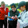 Runner Carolyn Bax, left, triathlon coach Angela Naeth, and runner Janice Karpes, go over lap times in Naeth's clinic at the Masich Place Stadium. Citizen photo by David Mah