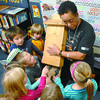 Judy MacKay also know as the bat lady shows a bat house during her presentation to primary students at Malaspina Elementary Monday morning.  Citizen photo by Brent Braaten