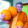 Roman Mutener brings more pumpkins to the front of St. Michael's church to be photographed with kids to raise funds for the Prince George Child Development Centre. Citizen photo by David Mah