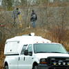 RCMP survey the site of a gravel pit along otway where human remains were found.  Citizen photo by Brent Braaten