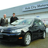 Fernie Jackson, left, and John Murchison from Hub City Motors with the 2010 Golf Wagon Confortline 2.5L Automatic.  Citizen photo by Brent Braaten