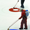 Dave Merklinger and Hans Wuthrich paint the rings on the ice at CN Centre Thursday afternoon for the Road to the Roar.  Citizen photo by Brent Braaten