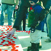Liam Milburn, 3, and his dad Dan, placed their poppies on the cenotaph after the Remembrance Day Ceremony. Citizen photo by David Mah