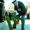 Sam Jones, Royal Canadian Naval Association President, places a wreath on the new cenotaph. Citizen photo by David Mah