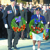 Don Ford, president of the Royal Canadian Legion Branch 43, and Loreen Bridges, Ladies Auxilliary president, move forward to place wreaths. Citizen photo by David Mah