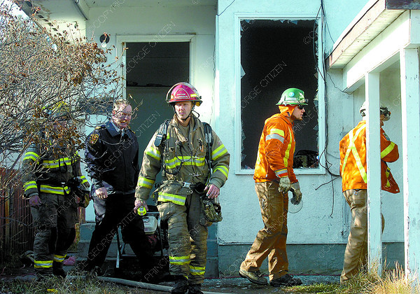 Prince George Firefighters and BC Hydro crews inspect a house at 2619 Quince Street after a fire started in a mattress in the basement. No one was home at the time of the call around noon. Citizen photo by David Mah