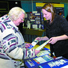 Henrietta Hillen, left, and Barb Oke, at the Healthy Community Environments booth look over brochures on radon and Seniors Falling Prevention.  Citizen photo by David Mah