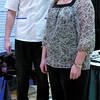 London Drugs pharmicist Matt Penner, measures Ann Herbert's height to determine body composition. Citizen photo by David Mah