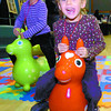 Five-year-old twins, Sophia, left, and Tatiana Leiva, had fun bouncing on the rubber horses at the Family Y booth, and the Healthier You Expo on the weekend at the Civic Centre. Citizen photo by David Mah
